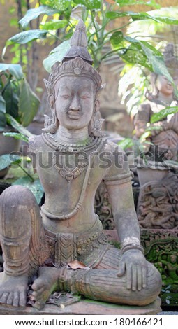 Buddha statue in the garden - stock photo
