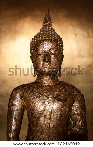 Buddha statue in the temple at Phetchaburi Province, Thailand.