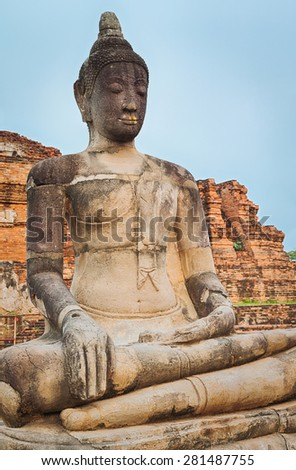 Buddha statue in Wat Mahathat. Ayutthaya historical park. Panorama - stock photo