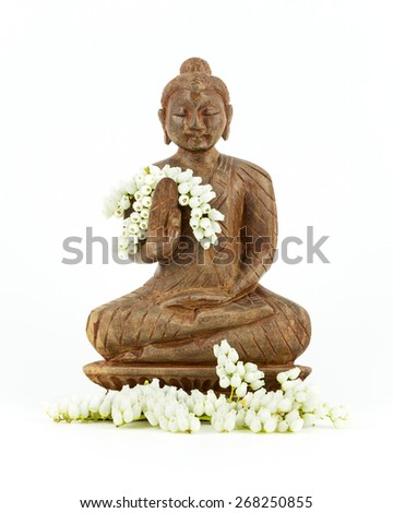 Buddha statue in wood on white background - stock photo