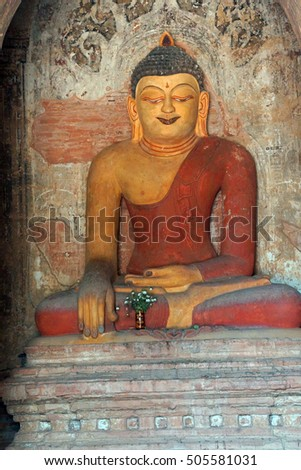 Buddha statue in Ywa Haung Gyi temple of red sandstone, Bagan Myanmar (Burma)