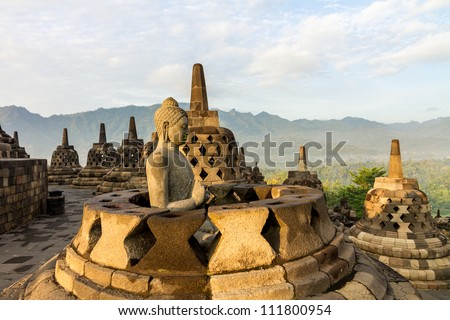 Buddha statue inside one of Borobudur temple stupas, Java island, Indonesia