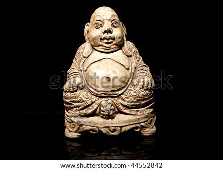 Buddha statue isolated on black background - stock photo