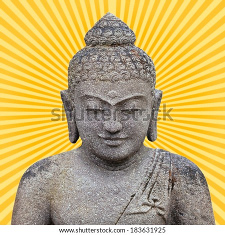 Buddha statue made of stone. Orange and yellow rays shining from the center of his head - added in post production. - stock photo