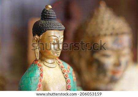 Buddha statue on background of Buddha face                        - stock photo