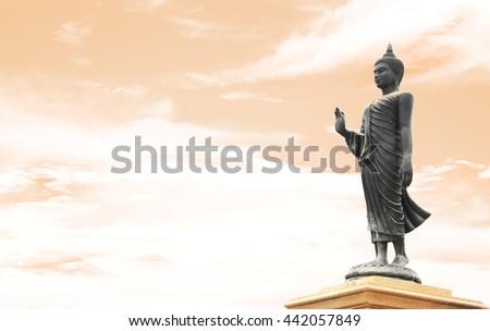 buddha statue on blue sky background - stock photo