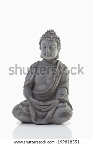 Buddha statue on white background, close up - stock photo