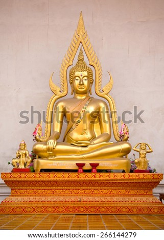 Buddha statue outside thai temple - stock photo