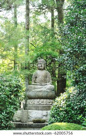 Buddha statue - Ryoan Ji, Kyoto, Japan - stock photo