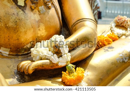 Buddha statue's hand Generally in Thailand, any kinds of decorated in Buddhist church, etc. they are public domain of Buddhism. Selective focus And Close up - stock photo