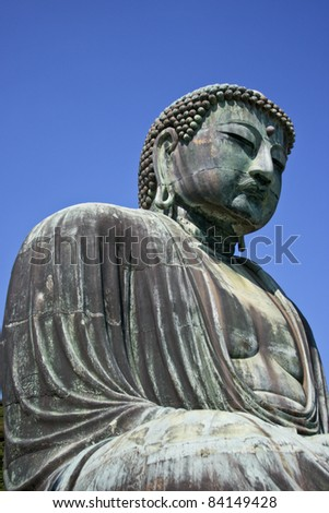 buddha statue shrine against a blue sky