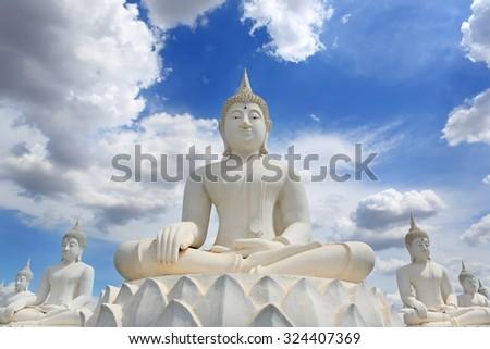 Buddha statue white with sky blue background  - stock photo