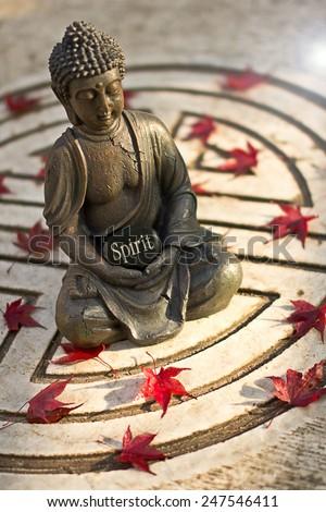 Buddha statue with the word  Spirit  - stock photo