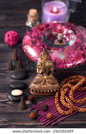 Buddha statue, zen stones and incense. concept of meditation and Zen - stock photo