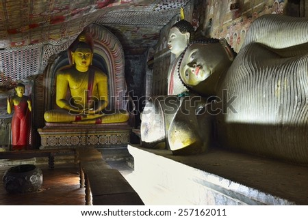 Buddha statues and murals in one of the cave temples of the Golden Temple, UNESCO World Heritage Site, Dambulla, Central Province, Sri Lanka, Asia - stock photo
