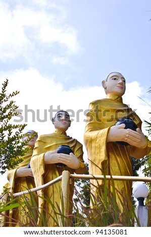 Buddha statues are alms round - stock photo