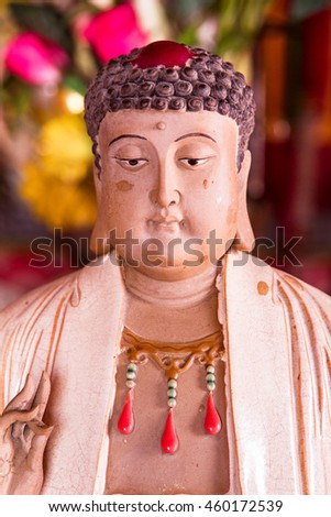Buddha statues in Chinese temple. - stock photo