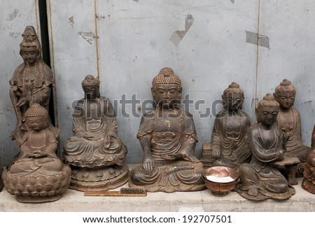 Buddha statues in Panjiayuan antique market, Beijing, China - stock photo
