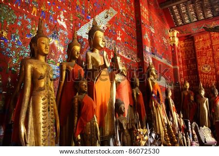 Buddha statues in Wat Xieng Thong in Luang Prabang Laos South East Asia - stock photo
