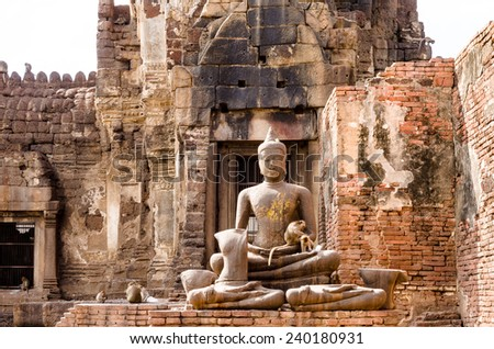 Buddha statues with monkeys at Phra Prang Sam Yot in Lopburi, Thailand - stock photo