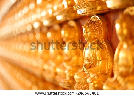 Buddha stature on the wall perspective view for background - stock photo