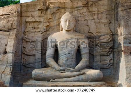 Buddha stone statue in meditation pose, Polonnaruwa, Sri Lanka - stock photo