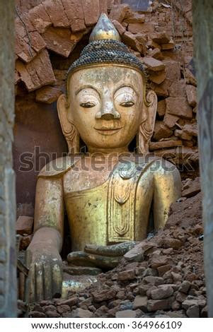 Buddha Surrounded in Bricks, Inle Lake, Myanmar - stock photo