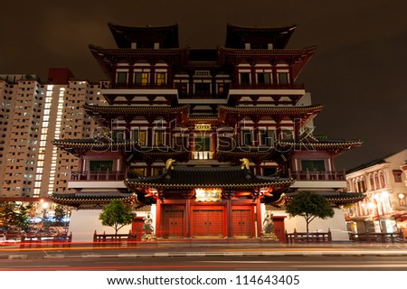 Buddha Tooth Relic Temple at dusk in Chinatown, Singapore - stock photo