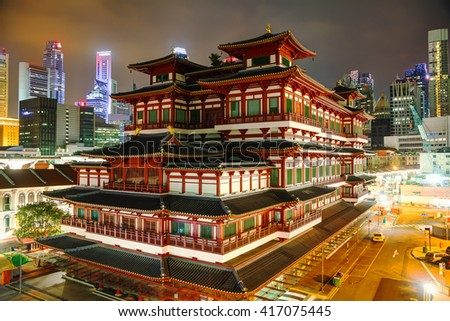 Buddha Tooth Relic temple in Singapore at night - stock photo