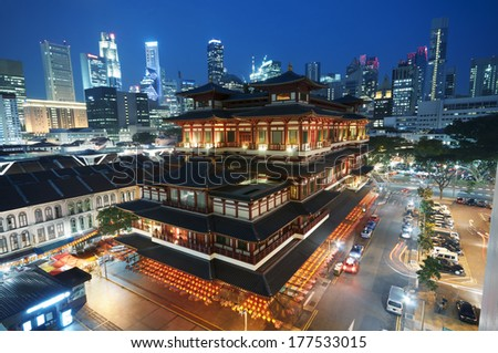 Buddha Toothe Relic Temple in Chinatown with Singapore`s business district in the background. - stock photo