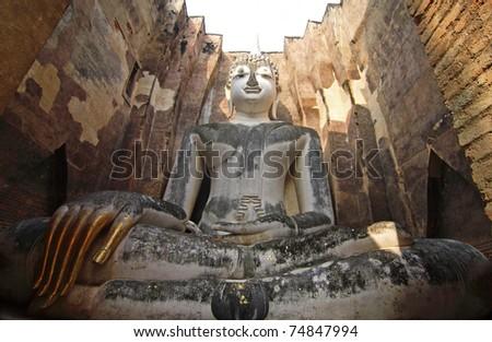 Buddha Wat Si Chum in Sukhothai historical park - stock photo