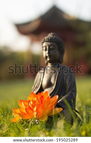 Buddha wellness meditation in nature - stock photo