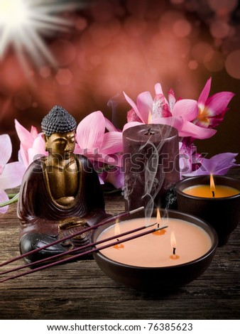 buddha with candle and incense with blur effect - stock photo