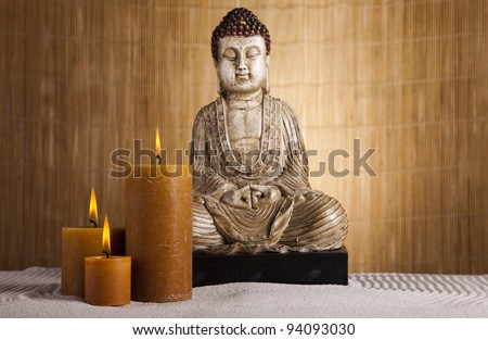 Buddha with candle, zen