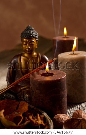 buddha with incense and candle - stock photo
