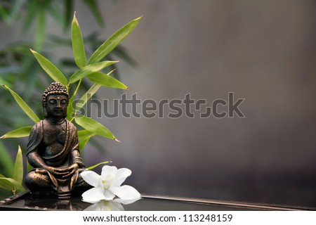 Buddha with orchid flower and bamboo. - stock photo