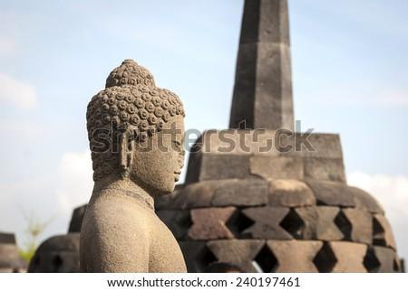 Buddha with stufa detail at Borobudur temple, Yogyakarta, Indonesia - stock photo