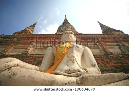 Buddhas at the temple of Wat Yai Chai Mongkol in Ayutthaya near Bangkok, Thailand. - stock photo