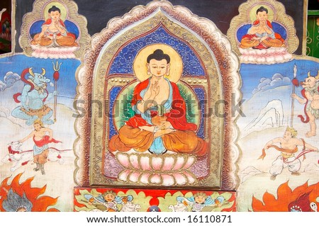 Buddhas painted on the wall in a monastery - stock photo