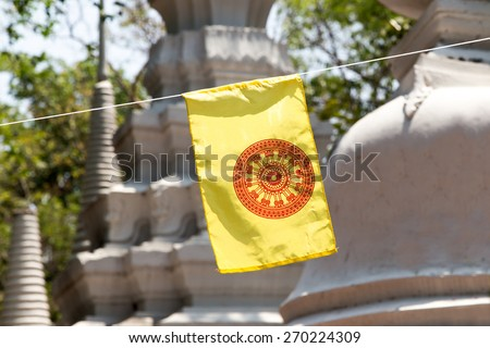 Buddhism flag among pagodas in Buddhist Temple in Thailand - stock photo