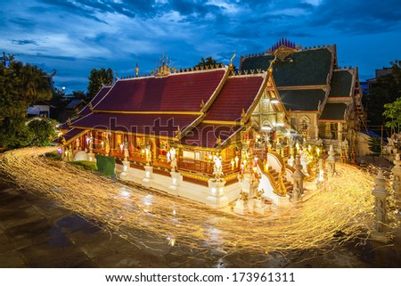 Buddhism light waving rite walk with lighted candles in hand around at Ming Muang Temple in Chiangrai , Thailand - stock photo