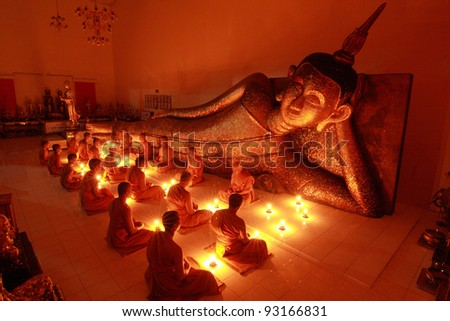 Buddhism Monk sit in the Temple in Thailand. - stock photo