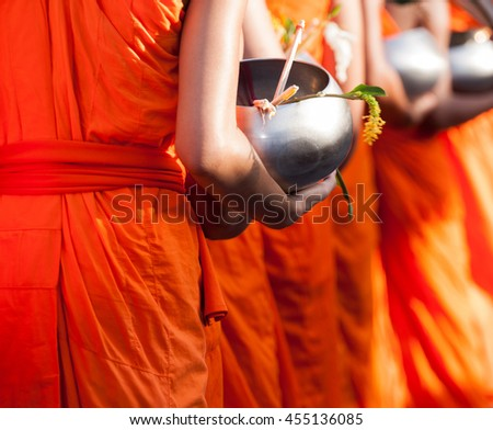 Buddhism monks alms bowl flower is festival and culture of Saraburi people in Thailand. - stock photo