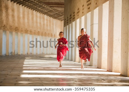 Buddhism novices are playing and relaxing at Shwezigon temple  - stock photo