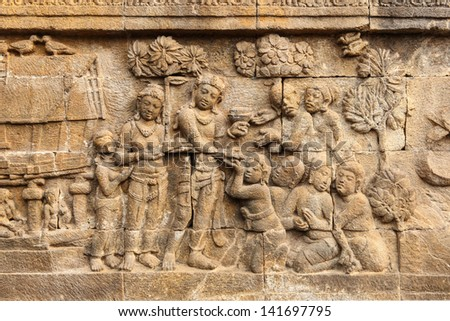 Buddhist bas-relief detail in borobudur temple