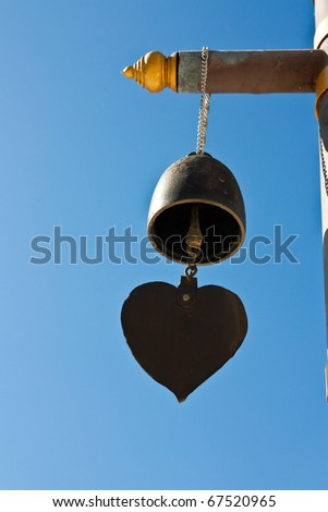 buddhist bell with blue sky - stock photo