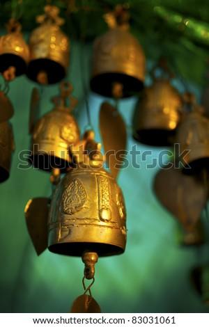 Buddhist bells inside the temple. Vertical shot. - stock photo