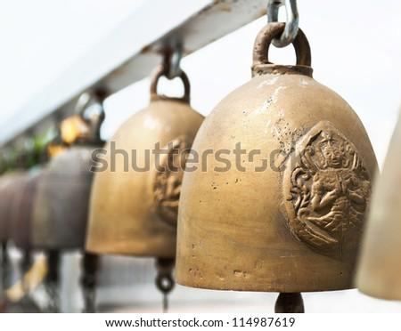 Buddhist bells. Shallow depth of field - stock photo