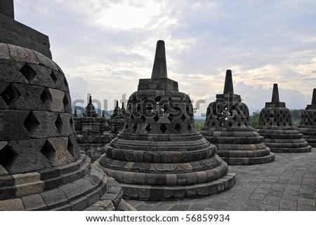 Buddhist Domes in Borobudur Temple, Indonesia - stock photo
