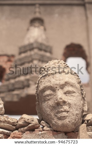 buddhist face made from sand stone
